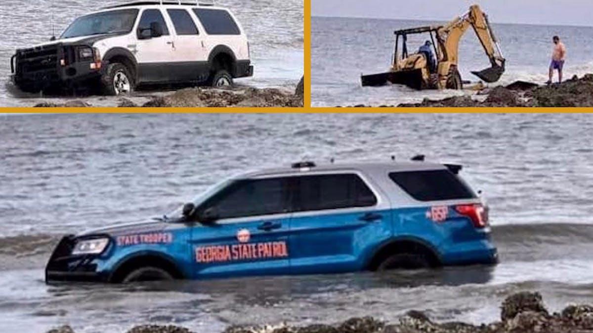 В США утопили два внедорожника и трактор, пытаясь достать изводы полицейскую машину